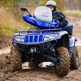 Man riding an ATV with proper engine insulation and isolation mounts for a smooth journey